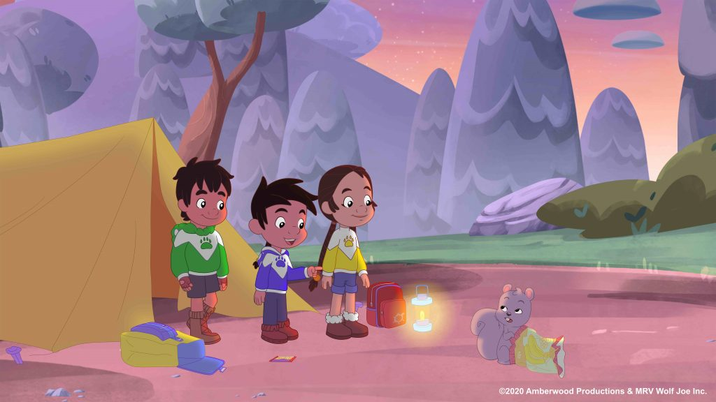 Joe, Buddy and Nina around a campfire