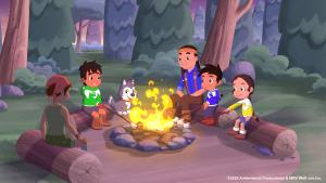 Joe and friends around a campfire